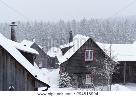Winter Landscape With A Wood House In A Foreground. Harz Mountains National Park, Torfhaus, Germany