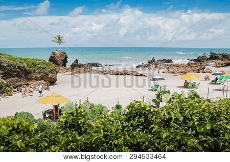 Conde - Pb, Brazil - February 22, 2019: Beach Umbrellas And Tourists At Praia De Tambaba Beach, Cost