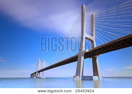 Vasco da Gama bridge spans the Tagus River in Lisbon, Portugal. It is the longest bridge in Europe (17.2 km) and was opened on 29 March 1998 for expo 98. It is located at the end of Lisbon' Park of Nations. poster