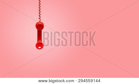 Red Old Telephone Receiver Hanging On Pink Background With Texting Space, Waiting For Phone Call, Vi