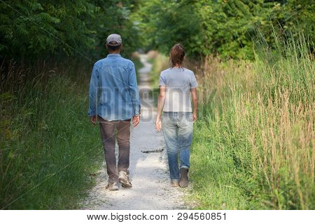 People Man Woman Unidentified Couple Walking Away Nature Trail Back Side