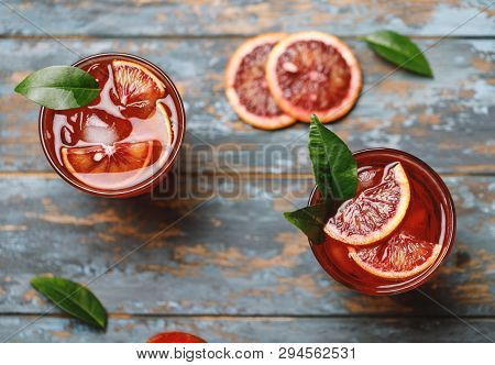 Blood Orange Juice With Ice And Orange Slice. Fresh Summer Cocktail With Red Oranges In A Glass. Fre