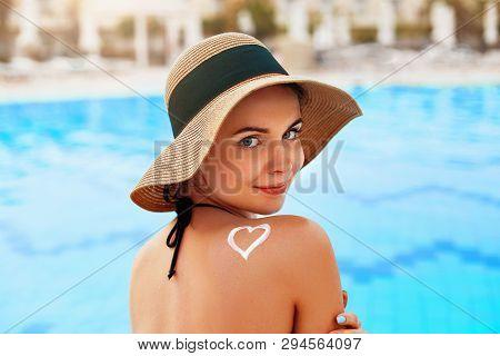 Suntan Lotion. Sexy Young Woman Applying Sunscreen Solar Cream. Sun Protection. Sun Cream. Skin And