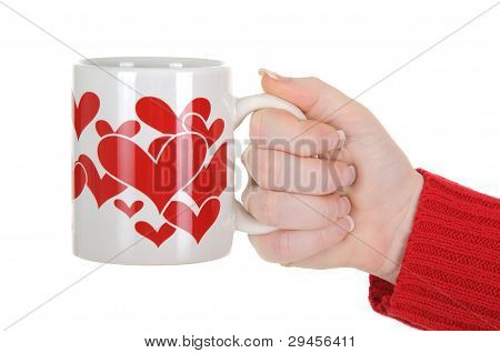 Female Hand Holding A Cup With Red Hearts