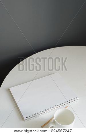 Blank Notebook With Ceramic Coffee Cup And Pencil On White Wooden Table In Loft Kitchen Interior, Fr