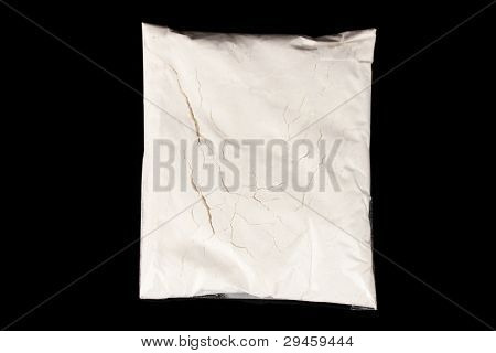 Cocaine in package on black background