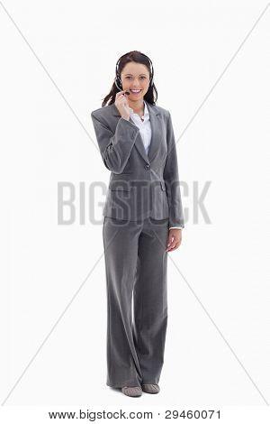 geschäftsfrau lächelnd und sprechen mit einem Headset against white background