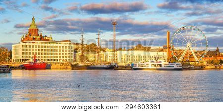 Panoramic view on Helsinki harbor at sunset, Finland