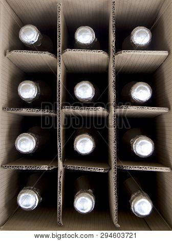 A Cardboard Case Of Sparkling Bottled Wine.