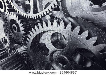 Industrial metal gears in a close-up. Cogwheels. Teamwork and clockwork symbol. Engineering. 3D illustration