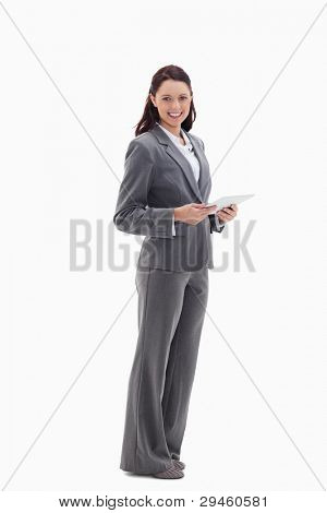 Profile of a businesswoman with a touch pad against white background