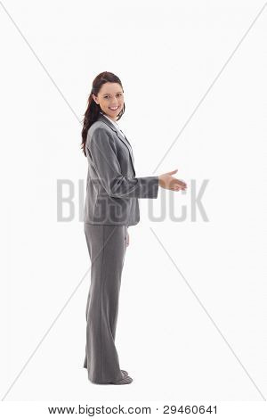 Profile of businesswoman smiling and shaking hands