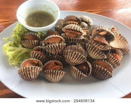 Scallop Cockles Seafood In White Plate Served With Spicy Seafood Souce