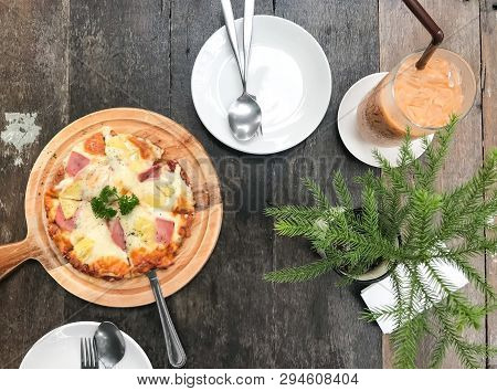 Home Made Pizza On Wooden Table,delicious And Yummy