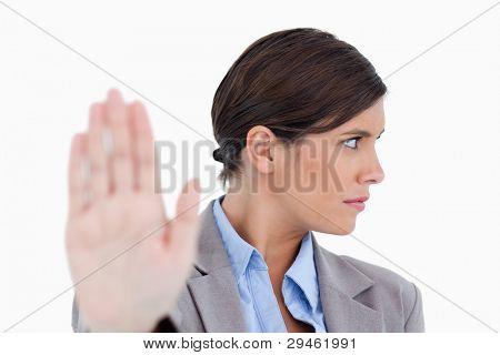 Close up of dismissive female entrepreneur against a white background
