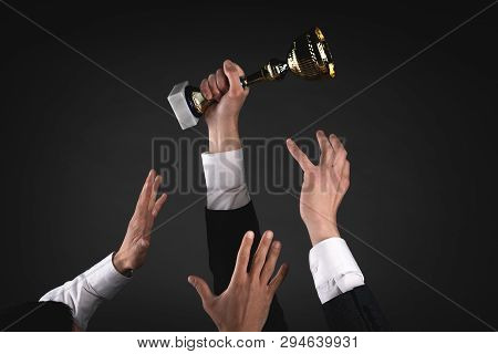 Golden Cup Award Trophy. Struggle For A First Place Concept Background. Thirst For Victory.