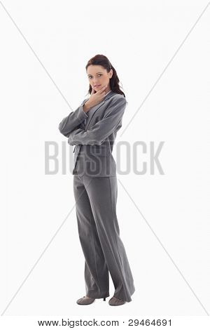 Profile of businesswoman with the hand on her chin against white background