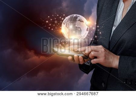 A Businessman Is Standing With A Device In Her Hands And Operating With The Network System Of Wirele