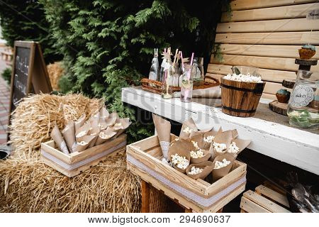Wedding Banquet Decorations. Wood Rustic Style Decor. Festive Table With Desserts, Snacks, Cakes, Bl