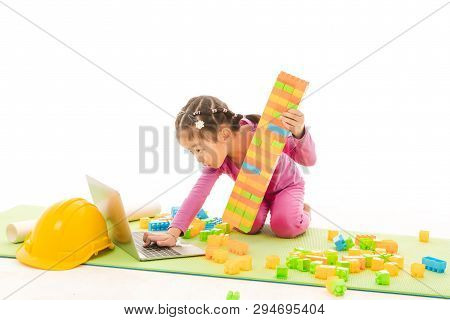 Shot Of Cute Little Asian Girl In Purple T-shirt And Pants, Role-playing Building Constructor Busily