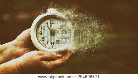 Retro Alarm Clock Or Vintage Alarm Clock In Old Hand. Time Is Running Out Concept Shows Clock That I