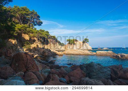Scenic Tropical Landscape In Spanish Coast In Lloret De Mar. Rocky Beach In Costa Brava, Spain On Cl