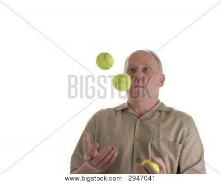 Man Juggling Tennis Balls