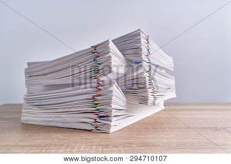 Close Up Pile Overload Paperwork Report On Wood Table