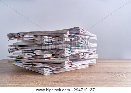 Close Up Pile Overload Document Report On Wood Table