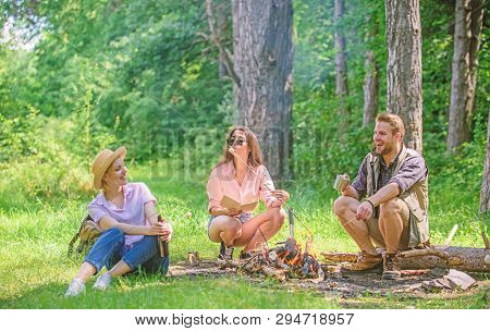 Take A Break To Have Snack. Company Hikers At Picnic Roasting Marshmallows Snacks. Company Friends P