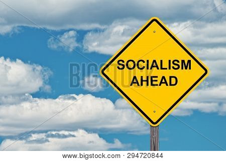 Socialism Ahead Caution Sign With Blue Sky Background