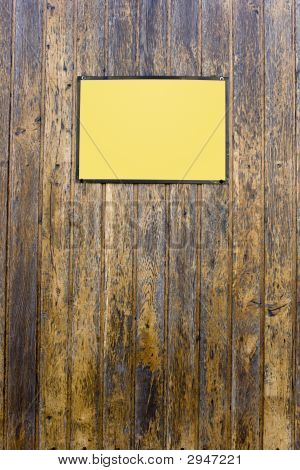 Grungy Wood Texture With A Yellow Sign For Background