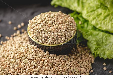 Croup Green Buckwheat On A Dark Background. Vegan Nutritious And Healthy Product. Concept Of Organic