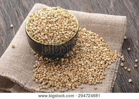 Green Buckwheat On A Dark Background. Vegan Nutritious And Healthy Product. Concept Of Organic Food