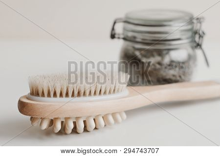 Wooden Brush For Body Massage And A Jar With Scrub. Spa And Body Care