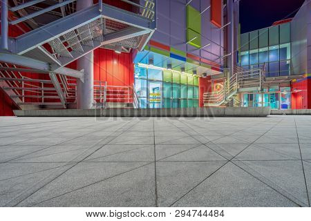 empty gound with modern building background at night, vancouver,canada.