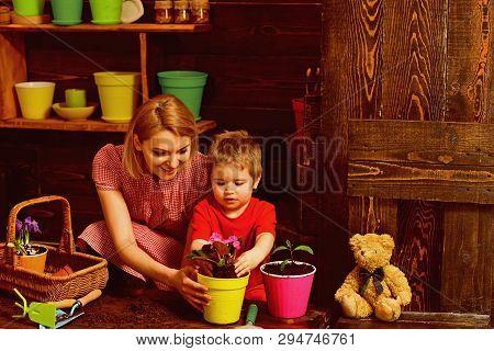 Environment Concept. Little Child Help Mother Planting Flower To New Pot, Environment. Environment A