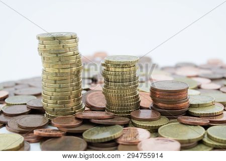 Stack Of Euro Cents Coins Of Different Value On White Background. Economy.