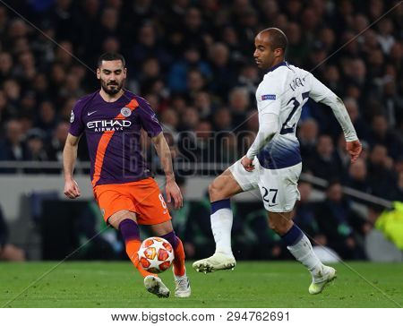 LONDON, ENGLAND: 09 MAR 2019. Ilkay Gundogan of Man City and Lucas of Tottenham compete for the ball  during the UEFA Champions League Quarter Final, First Leg match