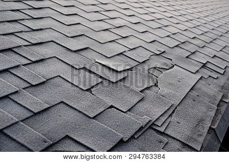 Close Up View On Asphalt Roofing Shingles Background. Roof Shingles - Roofing. Shingles Roof Damage
