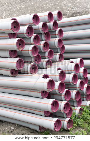 Many Stacked Long Plastic Pipe Tubes Ready For Building A Water Supply And Irrigation System