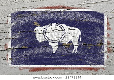 Flag Of Us State Of Wyoming On Grunge Wooden Texture Precise Painted With Chalk