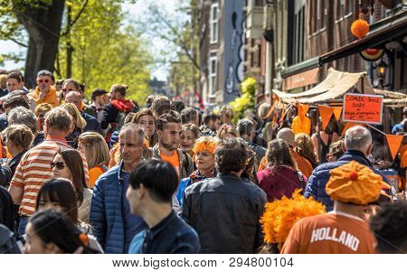 Amsterdam, The Netherlands - April 27 2018: Crowd Of People Browsing On Vrijmarkt Flea Market On Ann