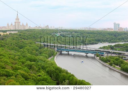 Moscow River, Luzhnetsky Bridge (Metro Bridge), Moscow State University and panorama of Moscow, Russia poster