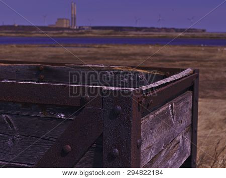 Coal Mining Haulage Box With Coal Fired Power Plant In Background