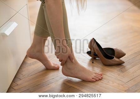 Tired Woman Touching Her Ankle, Suffering From Leg Pain Because Of Uncomfortable Shoes, Feet Pain We