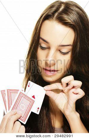 beautiful woman picks a poker card