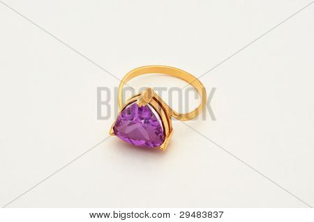 The Brilliant Gold Ring With A Stone Lying On A White Background.