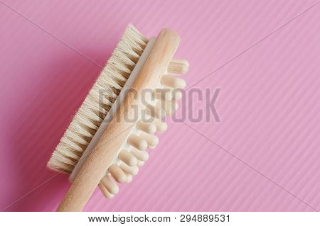Multipurpose Wooden Brush For Massage On Pink Background. Dry Body Massage. Cellulite Treatment Beau
