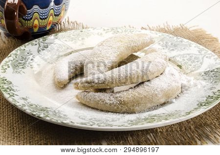 Classic Vanilla Kipferl, Traditional German Cookies With Powdered Sugar On A Plate